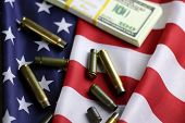 many shell casings from bullets of different caliber in the background chaos concept in the world poster