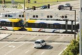 a light rail mass transit train crossing an intersection in Bloomington MN poster