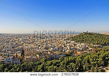 View From Acropolis Hill Of The City Of Athens And The Monument Of Philopappos On Musaios Hill In At