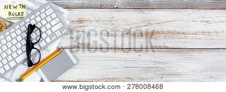 Income Tax Forms With New Rule Changes Plus Traditional And Cyber Currency On White Rustic Desk