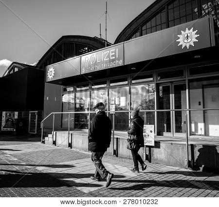 Hamburg, Germany - Mar 20, 2018: Senior Man And Woman Passing By Police Polizei Station Near Hamburg