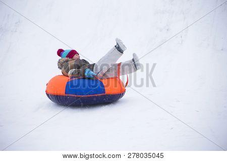 Sledding.happy Child On Vacation. Winter Fun And Games.little Boy Enjoying A Sleigh Ride.children Pl