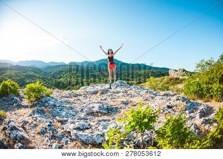 A Slender Girl Is Resting In Nature. The Athlete Is Resting After A Run. Woman In The Background Of