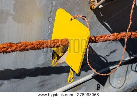 Vermin Stoppers - Keeping Berthed Vessel Vermin Free. Marine Rat Guard On A Ship. Mooring Ropes To P