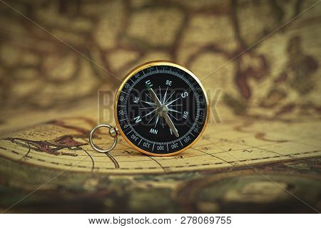 Compass On Blur Vintage Map Background, Retro Color Tone, Direction Journey Planning Concept, Blank