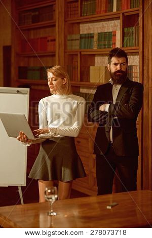 Internet Surfing Concept. Pretty Woman And Bearded Man Perform Internet Surfing On Laptop. Universit