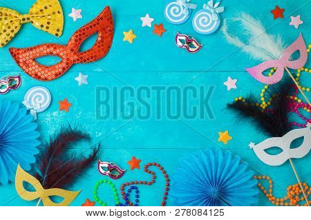 Carnival Or Mardi Gras Background With Carnival Masks, Beards And Photo Booth Props. Top View From A
