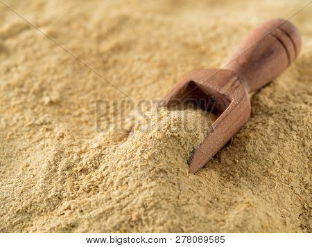 Nutritional Yeast Background. Nutritional Inactive Yeast With Small Wooden Scoop. Copy Space. Nutrit
