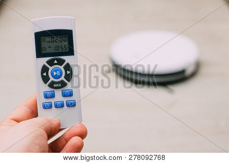 Closeup Remote Control Of Robotic Vacuum Cleaner
