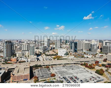 Top View Skyscraper Buildings In Uptown Dallas With Colorful Aut