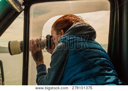Mature Woman Tourist Professional Photographer Taking Photo From Camper Car With Camera, Driving On