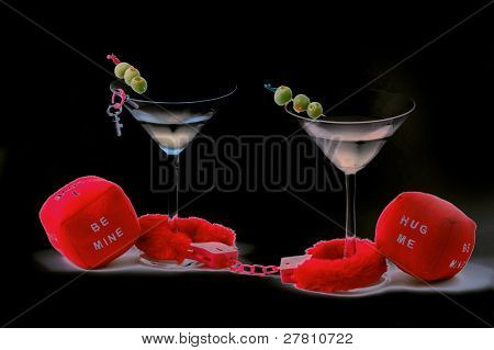 Valentine's Day image depicting the concept Caught in love.Ffurry handcuffs and Martini's