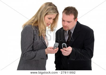 Business people entering phone numbers into their cell phones