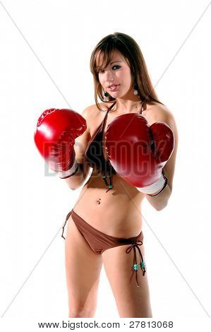 Sexy redheaded bikini  model in boxing gloves  isolated over white