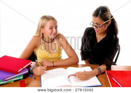 August means Back To School,  Teacher and student share some one on one instruction time in a classroom environment  isolated over white.