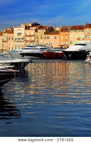 Luxury boats docked in St. Tropez in French Riviera poster