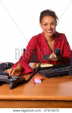Beautiful female executive picking up a telephone call  in the office.