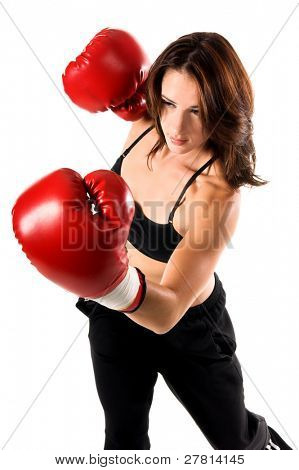 Sexy and well fit female boxer throws a good left hook followed by an overhand right