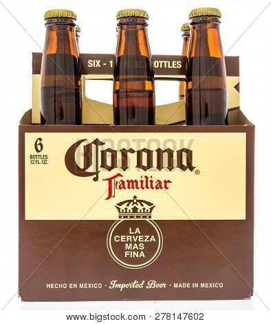 Winneconne, Wi - 10 January 2019:  A Six Pack Of Corona Famliar Beer From Mexico On An Isolated Back
