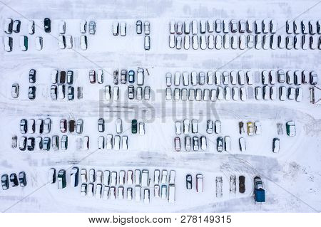 Rows Of Parked Cars Covered With Snow. Parking Lot With Vacant Parking Places. Drone Photo