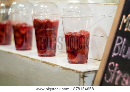 Strawberry And Syrup In The Plastic Glass Show On The Shelf Prepare For Made To Smoothies By The Cus