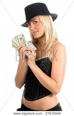 Beautiful and sexy young blonde gangster girl in a pinstripe hat and corset top with a Hearts Royal Flus and a handful and poker cards