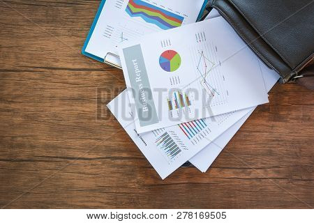 Business Report Chart Preparing Graphs On Briefcase Bag / Summary Report In Statistics Circle Pie Ch