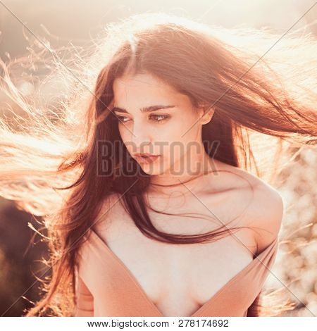 Girl With Decollete Enjoy Her Hair Waving By Wind. Woman On Calm Face Enjoy Sunny And Windy Day, Nat
