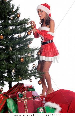 Sexy Ms. Santa Claus decorating the Christmas Tree