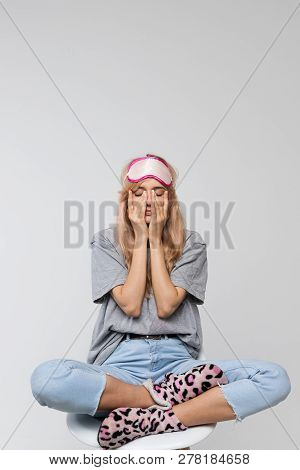 Studio Portrait Of Sleepy Teenager In Grey T-shirt Rubbing Her Eyes, Feels Tired After Study, Front