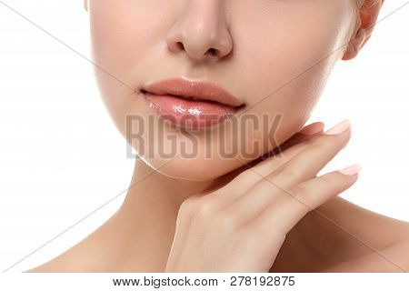 Close Up View Of Young Beautiful Caucasian Woman Touching Her Face Isolated Over White Background. L