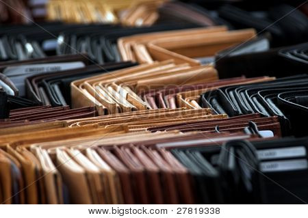 A table full of leather wallets at the flea market