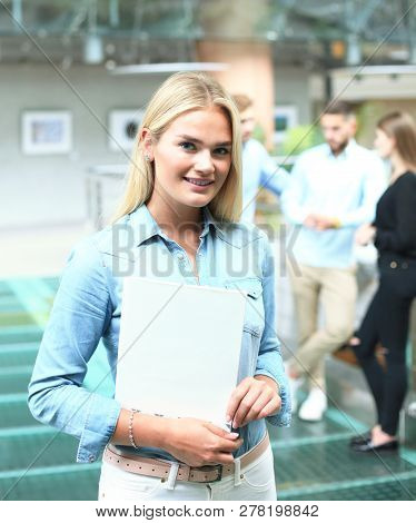 Business Woman In Casual Wear With Her Staff, People Group In Background At Modern Bright Office.