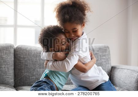 Cute Happy African American Siblings Hugging Cuddling Feeling Lo