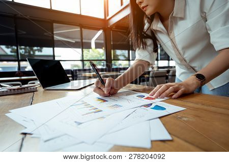 Business Analyzing Charts And Graphs Of Businesswoman Her Hustle Writing Note With Digital Laptop Co