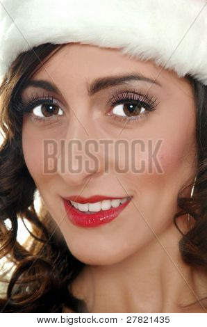 Close up portrait of a woman in a fur trimmed Santa hat