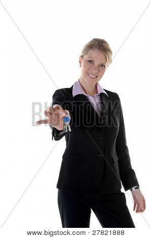 Beautiful blonde Real Estate Executive holding out a ring of keys for a new home. Focus on models eyes