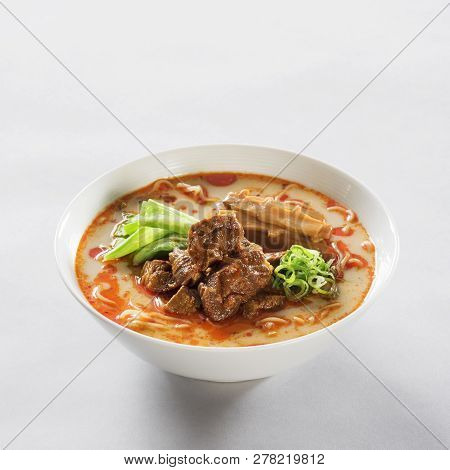 Japanese Pork Bone Soup Ramen In A White Bowl