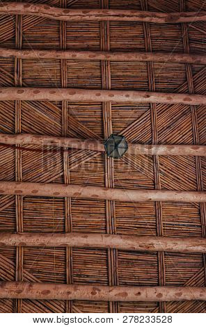 Maroccan wooden twig ceiling. Bamboo ceiling in african house. Traditional wooden ceiling in the home of the Berbers poster