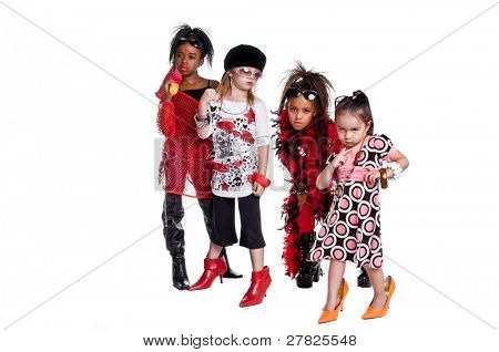 Multi ethnic group of young girls playing Girl band dress up
