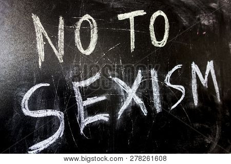 No To Sexism Written In White Chalk On A Black Chalkboard.