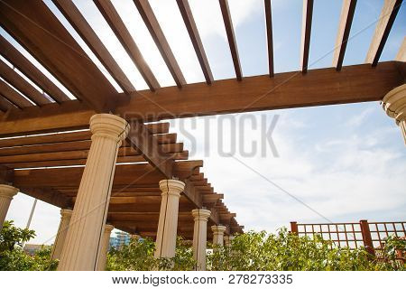 Modern Outdoor Patio With Stone Floor And Wooden Pergola