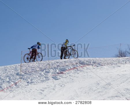 Couple Of Professional Winter Bikers In Mountains Tien Shan At Contest