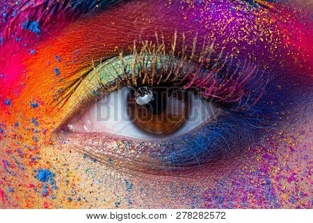 Close Up View Of Female Eye With Bright Multicolored Fashion Makeup. Holi Indian Color Festival Insp