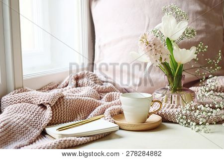 Cozy Easter, Spring Still Life Scene. Cup Of Coffee, Opened Notebook, Pink Knitted Plaid On Windowsi