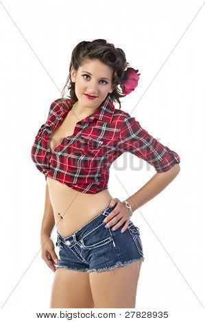 Beautiful young woman in flannel shirt and denim shorts