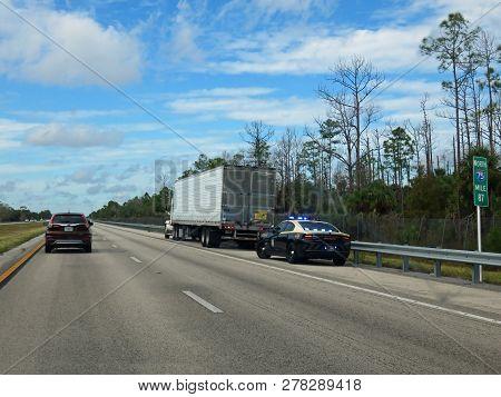 I-75 Florida, Fl - November 24:  Florida State Trooper Pulling Over Semi Truck On Northbound I-75 Kn