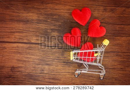 Valentines Day Shopping And Red Heart On Shopping Cart Love Concept / Shopping Holiday For Love Vale