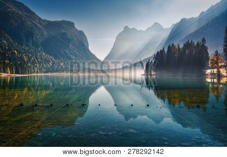 Majestic Mountains Reflected In Water In Beautiful Dobbiaco Lake At Sunny Morning In Autumn.  Fall I