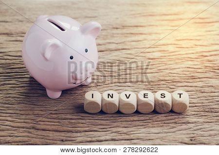 Investment, Finance, Banking, Saving Money Concept, Pink Piggy Bank With Wooden Cube With Alphabets